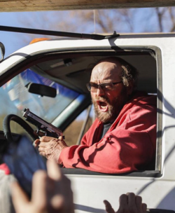 Dapl employee brandishes handgun before driving truck through crowd