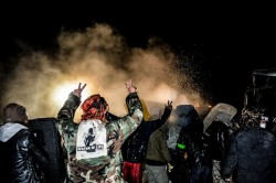 Riot police spray activists at backwater bridge - photo by rob wilson photography
