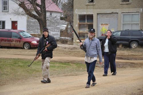 Craig Cobb and Dutton marching through Leith with weapons - photo by Gregory Bruce