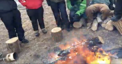 Activists surround fire lit at Last Childs Camp - video still provided by Chase Iron Eyes