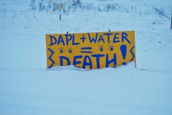 Signs in the snow outside of the Standing Rock camps - photo by C.S. Hagen