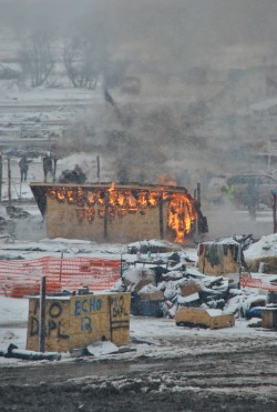 Burning of the grand stand - place where speeches were given before the first Oceti Sakowin fire - photo by C.S. Hagen
