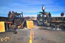 NO DAPL - activists destroy dapl trucks on backwater bridge - photo by C.S. Hagen