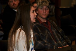 Lamar Heidersheid looks on as his daughter Angelina speaks before the Native Amerian Commission - photo by C.S. Hagen