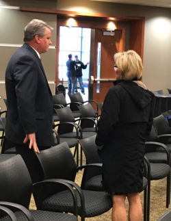 Municipal airport authority Steve Blazek speaks with newly-appointed teacher Tammy Linn after City Commisioners meeting - photo by C.S. Hagen