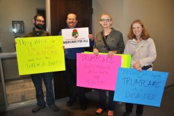 Afl-cio President Waylon Hedegaard and member Andrew Buschaw, indivisible members Cheryle Schaafle and Karen Halsa before Hoevens office in Fargo - photo by C.S. Hagen