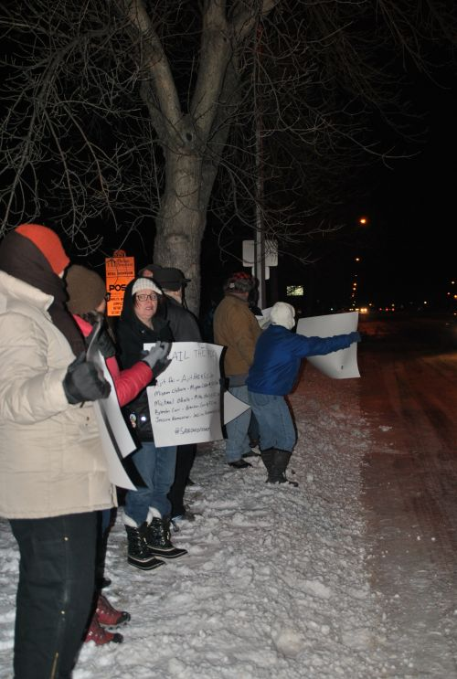 Protesters outside of Congressman Kevin Cramer's office in Fargo - photo by C.S. Hagen