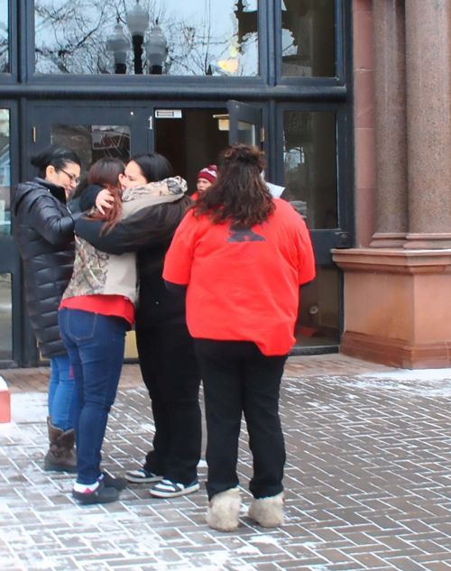 Norberta Greywind hugging after Brooke Lynn Crews pleaded guilty in Cass County District Court - photo by C.S. Hagen