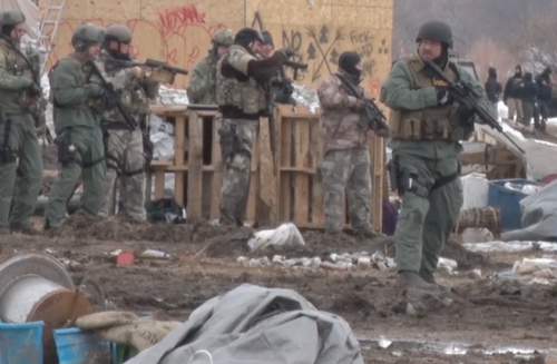 Well armed police prepare to clear an area - photo provided by North Dakota Joint Information Center