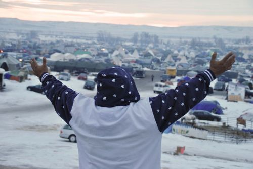 Activist at Standing Rock greets the morning - photograph by C.S. Hagen