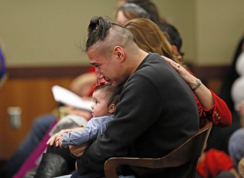 Ashton Matheny with Haisley Jo in court - photograph by Dave Samson of the Minneapolis Star Tribune
