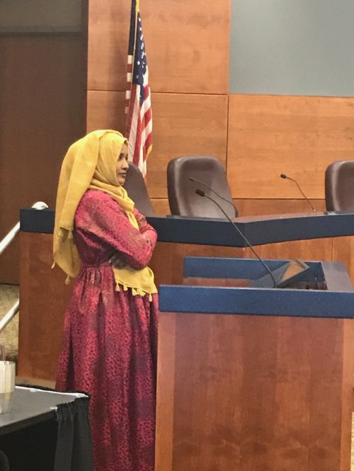 Habsa Yusuf speaking before Fargo's Human Relations Commission - photograph by C.S. Hagen