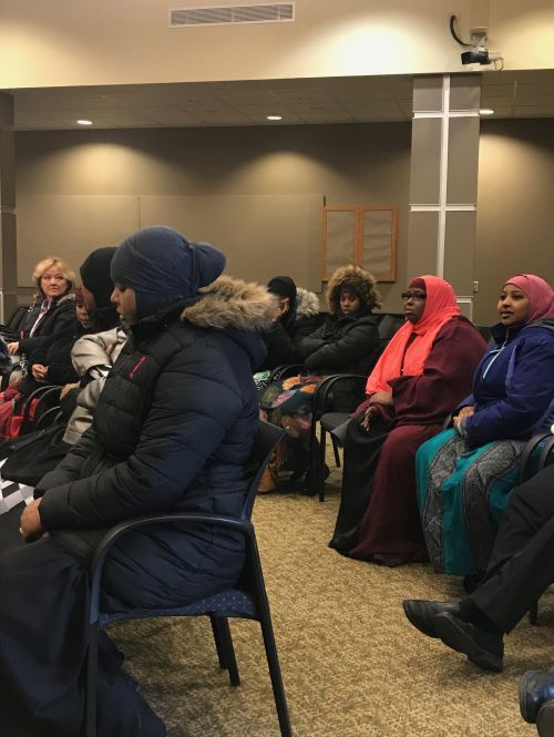 Some of the women gathered who came to speak and support their claims of discrimination at Fargo's Walmart - photograph by C.S. Hagen