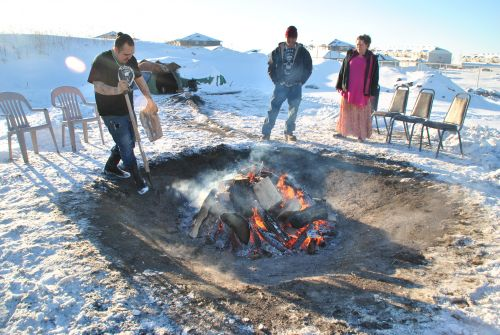 Zebadiah Gartner and others preparing the stones for Fargo's Indigenous swear lodge - photograph by C.S. Hagen