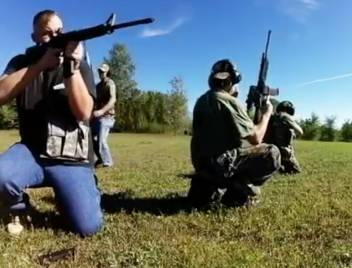 Members of the North Dakota Security Force III% practicing at targets before blowing up mosque replica - video snapshot