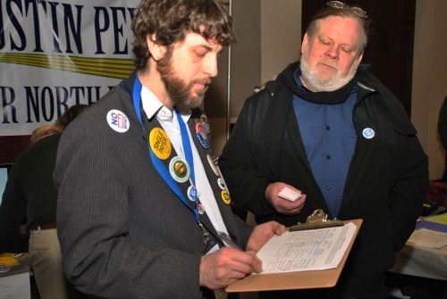 David Dustin Peyer who plans to run for the Senate seat, signs a petition to raise minimum wage to $15 an hour - photograph by C.S. Hagen
