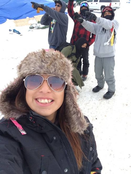 Laycie Williams with fellow security at Oceti Sakowin - photograph provided by Melaine Stoneman