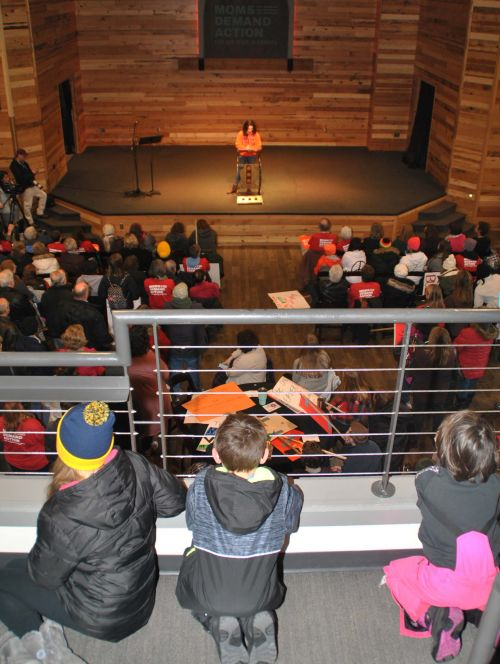 Children listening to Davies High School student and an organizer of March for our Lives Fargo, Madeline Cano speak in front of hundreds of people protesting lack of gun control - photograph by C.S. Hagen