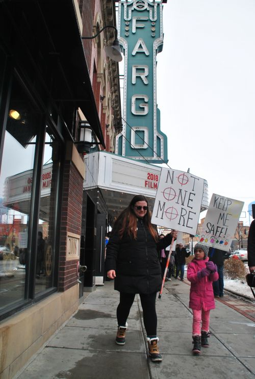 Parents and young children all marched holding signs, anc chanting - which could be heard from six blocks away - photograph by C.S. Hagen