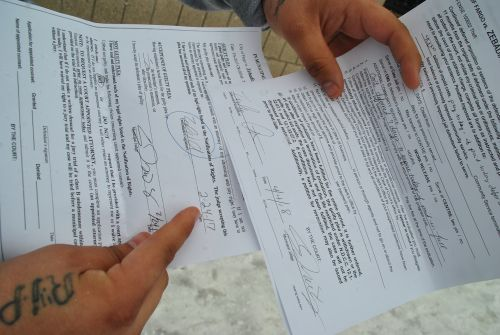 Paperwork showing Zebadiah Gartner's signatures, which he claims he never signed to his guilty verdict - photograph by C.S. Hagen