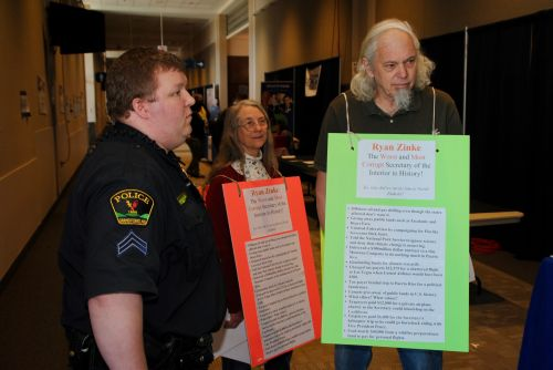 Dexter and Betsy Perkins, of Grand Forks, approached by police and escorted out during the ND GOP Convention - photograph by C.S. Hagen