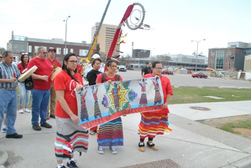 Marchers for MMIW awareness stop before the new Fargo City Hall - photograph by C.S. Hagen