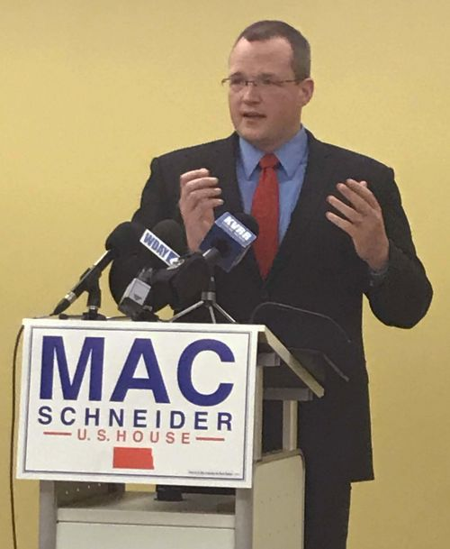 Mac Schneider, candidate for US Congress, speaks about continuing bipartisan effort to defend health insurance for those with preexisting conditions - photograph by C.S. Hagen.jpg