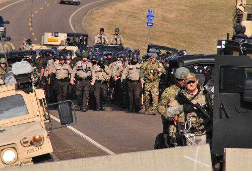 Law enforcement closing in on Backwater Bridge - photo by C.S. Hagen