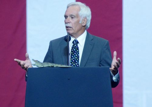 Former Governor Ed Schafer speaking before President Trump's Make America Great Again Rally in Fargo - photograph by C.S. Hagen