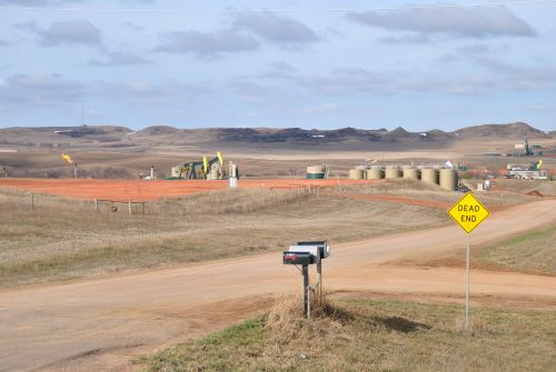 The Bakken oil rigs and flaring can be seen as far as the eye can see - photograph by C.S. Hagen