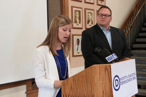 Kylie Oversen, Democratic candidate for Tax Commissioner, and Josh Boschee, Democratic candidate for Secretary of State, announce their plans to modernize state government services - photograph by C.S. Hagen