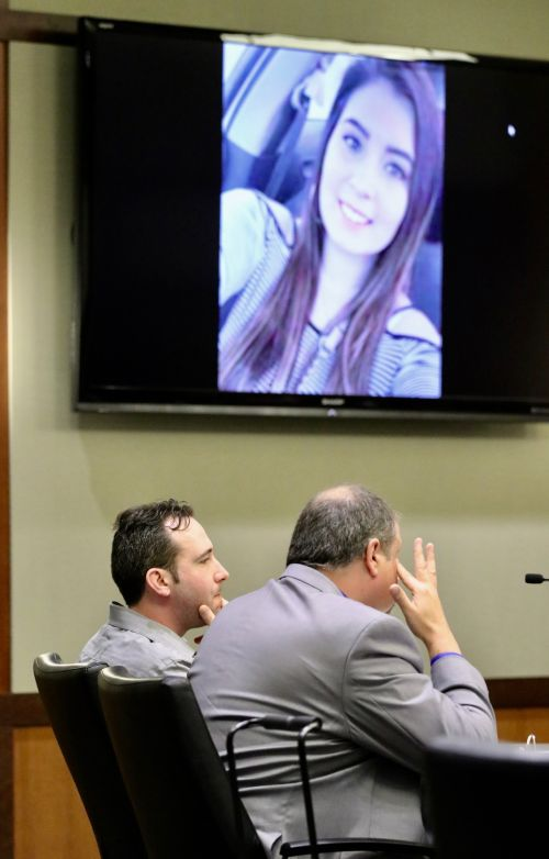 William Hoehn and defense attorney Daniel James Dorgen in court with picture of Savanna Greywind on court monitor - photograph by C.S. Hagen