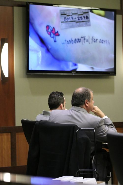 Medical examiner's Too beautiful for earth tattoo photograph on Savanna Greywind's foot and one of the accused murderers, seated left, William Henry Hoehn - photograph by C.S. Hagen