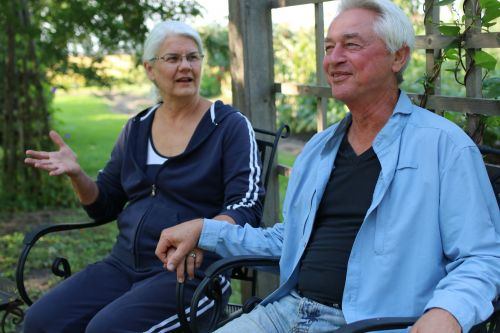 Donald and Cathy Heitkamp in their back yard in Mooreton, ND, discussing their legal struggles against the ND Agricultural Department - photograph by C.S. Hagen