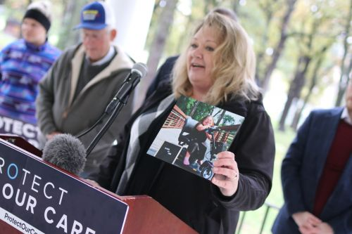 West Fargo resident Jennifer Restemayer speaks about health care issues in Fargo's Island Park - photograph by C.S. Hagen