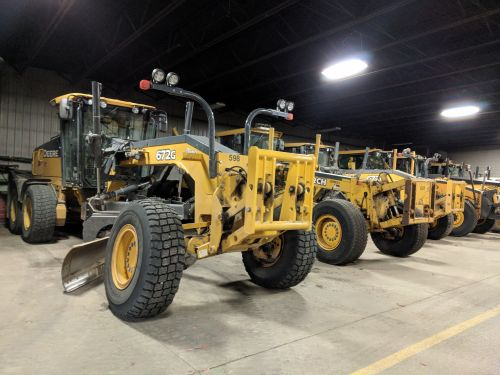Motor graders lined up at Fargo Public Works - photograph by Ryan Janke