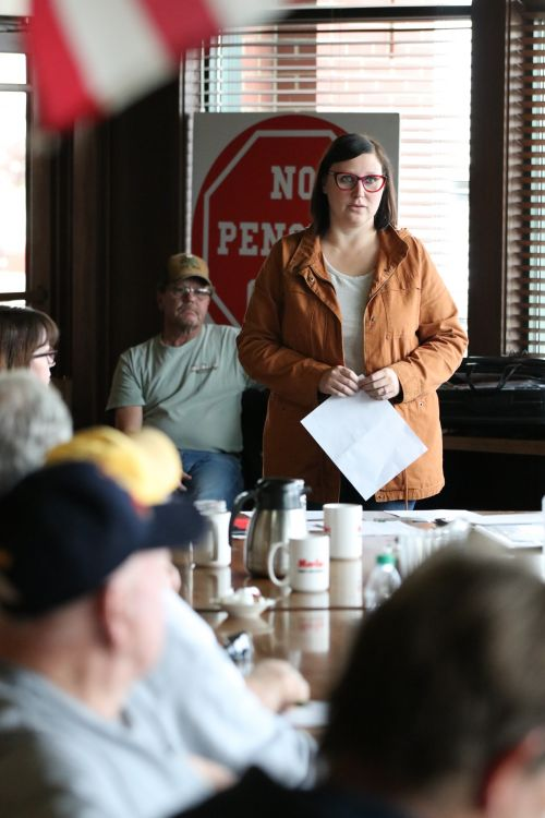 Callie Detar speaking before the group of concerned citizens fighting to keep their pensions - photograph by C.S. Hagen