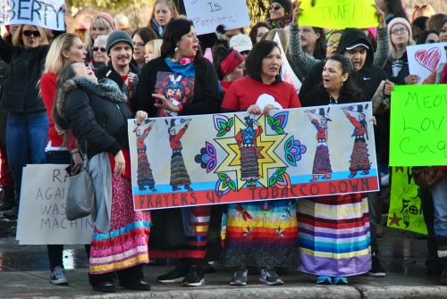 Native women during a rally against hate in Fargo - photograph by C.S. Hagen