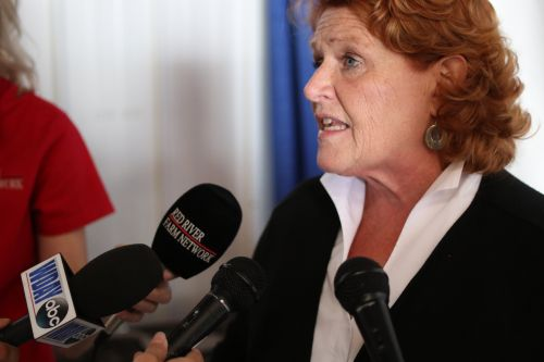 Senator Heidi Heitkamp talking to reporters during an interview earlier this year - photograph by C.S. Hagen
