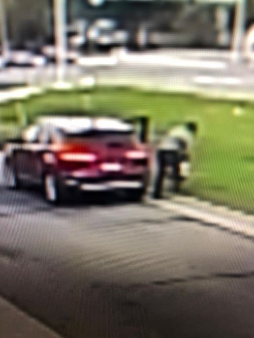 Grainy video footage of a person stealing yard signs in Moorhead - Facebook