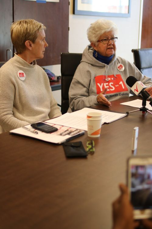 Ellen Chaffee, a founder of North Dakota for Public Integrity, and Dina Burcher talk to the press - photograph by C.S. Hagen