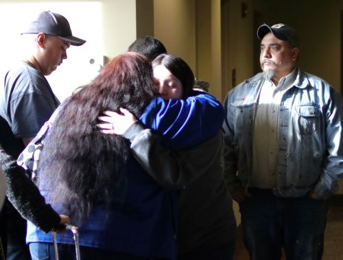 Friends and family of the Greywind's hug after sentencing - photograph by C.S. Hagen