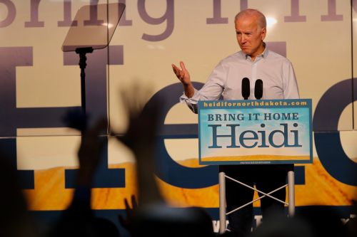 Former Vice President Joe Biden speaks at the Fargo Air Museum to kick off Bring It Home Heidi! final campaign stretch before Election Day - photograph by C.S. Hagen