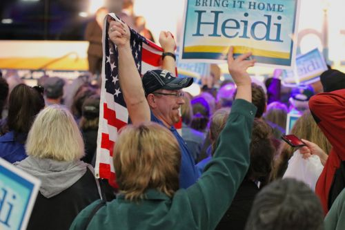 Hundreds of people attended Bring It Home Heidi! rally at the Fargo Air Museum Thursday morning - photograph by C.S. Hagen