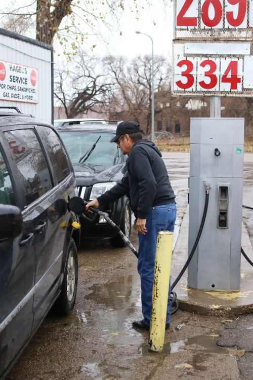 Dale Brave Crow, a South Dakotan Standing Rock Sioux Tribe member fills up on gasoline that the tribe will pay for - photograph by C.S. Hagen