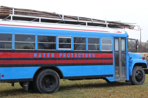 Smaller Standing Rock Water Protector bus that will be driving people to the polls on November 6 - photograph by C.S. Hagen