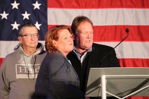 Heidi and brother Joel Heitkamp with Heidi's husband before she concedes the race - photograph by C.S. Hagen