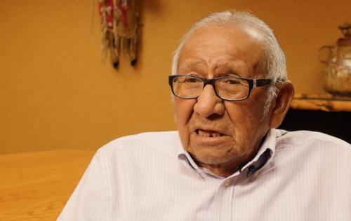 Elder tribal member Richard Broken Nose speaking on the devestation to his house - video screenshot by Charles Banner