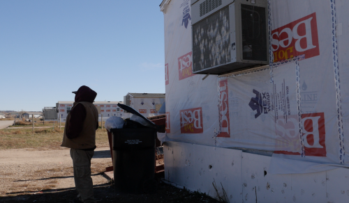 FEMA homes and trailers wrapped in Rex Wrap in the village of Oglala - video screenshot by Charles Banner