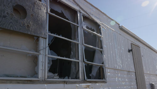 Hail damaged homes including windows, doors, roofs - video screenshot by Charles Banner